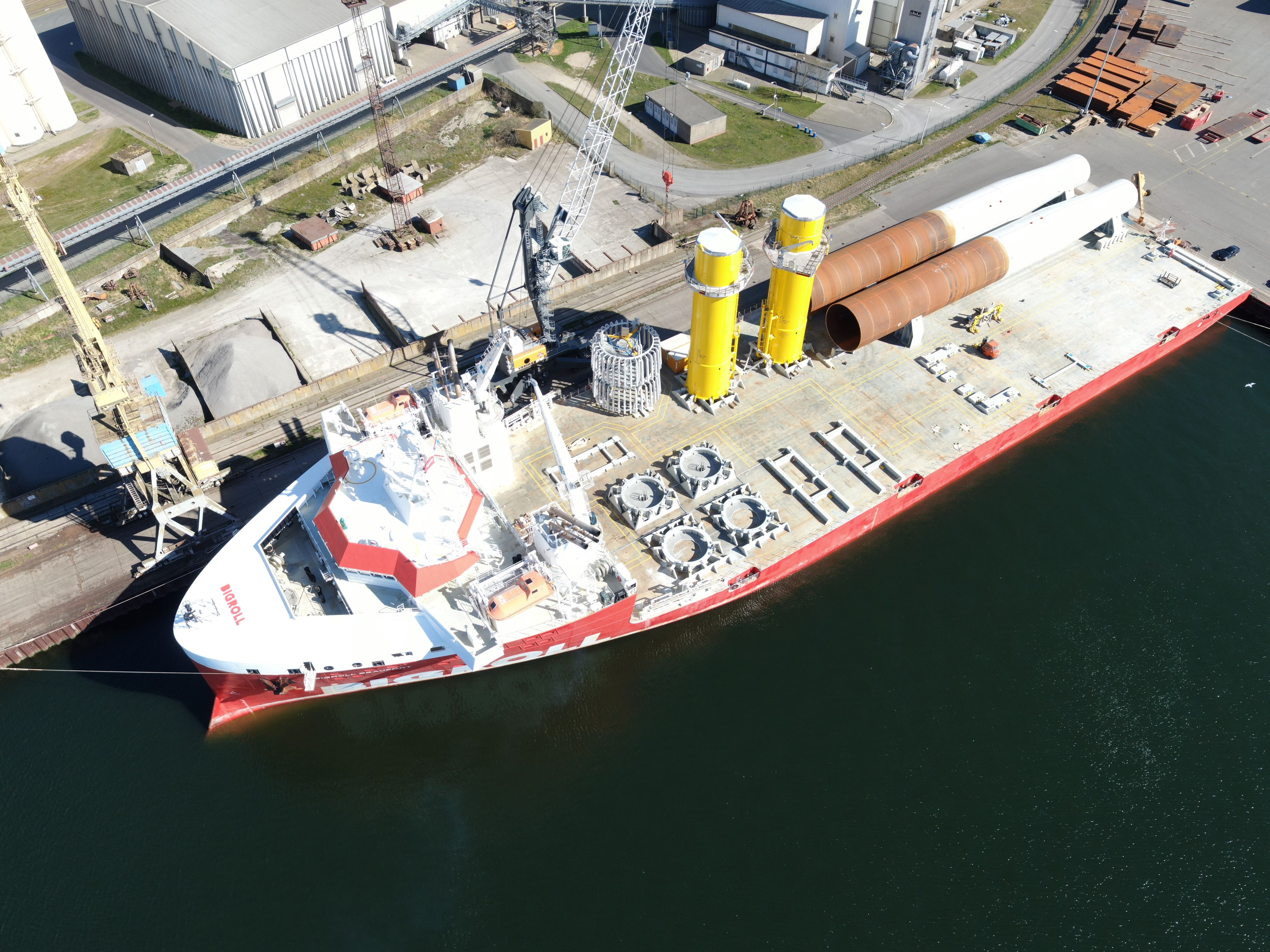 Loadout of the two monopiles and transition pieces at EEW SPC quay in Rostock.
