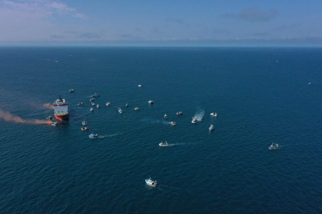 Aethra surrounded by French fishing boats at Saint-Brieuc offshore wind farm
