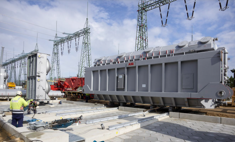 A 320-tonne transformer is placed on the foundation equipped with rails at Lubmin substation site