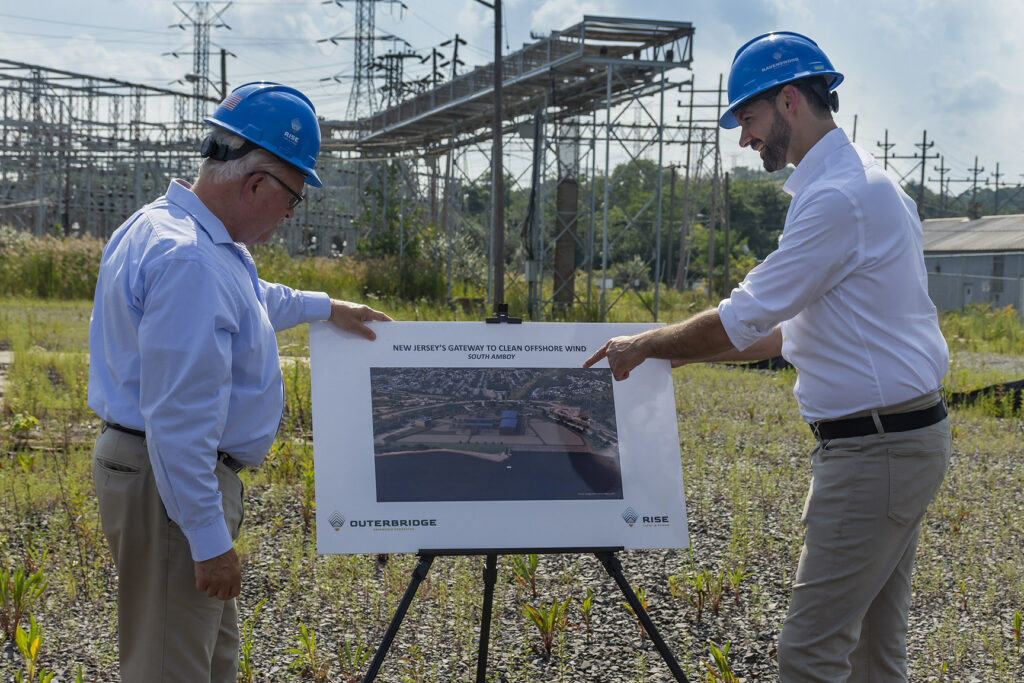 A photo of South Amboy Mayor Fred Henry and Rise Light & Power CEO Clint Plummer review future plans to transform the former coal-fired Werner Generating Station into a clean energy hub