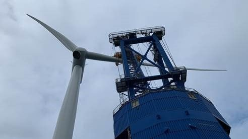 A photo of a wind turbine at Hornsea Two during blade installation