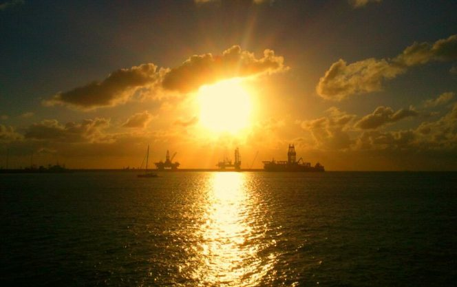 Offshore drilling rigs, sunset, image