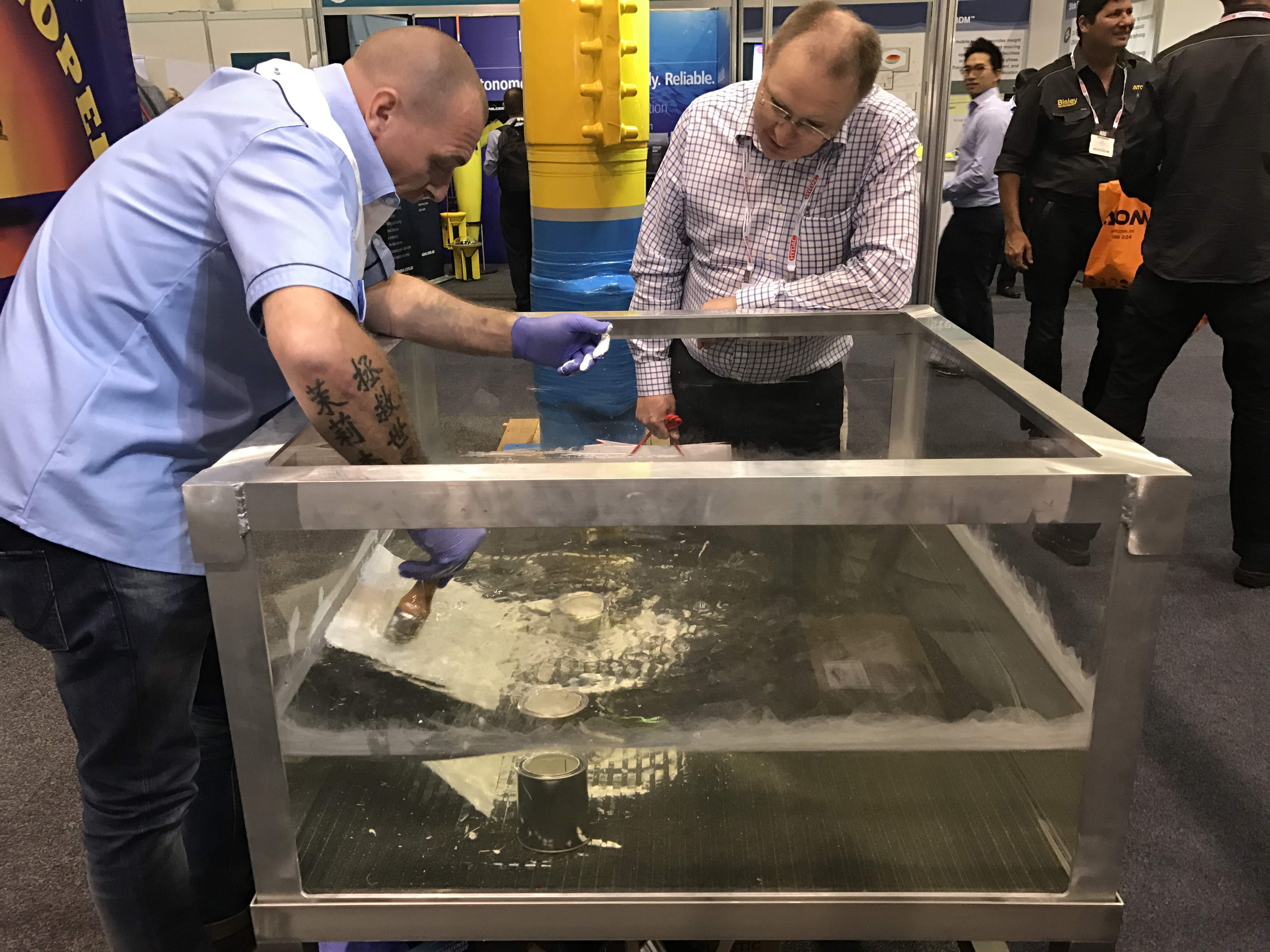 A demonstration at the Australian Oil & Gas Expo of Alocit being applied under water