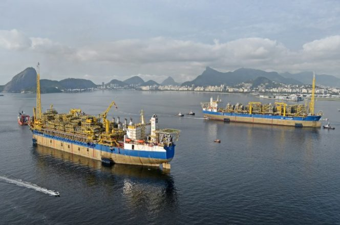 SBM Offshore's twin FPSOs pass in Guanabara Bay as Cidade de Maricá departs from and Cidade de Saquarema arrives at Brasa shipyard December 2015