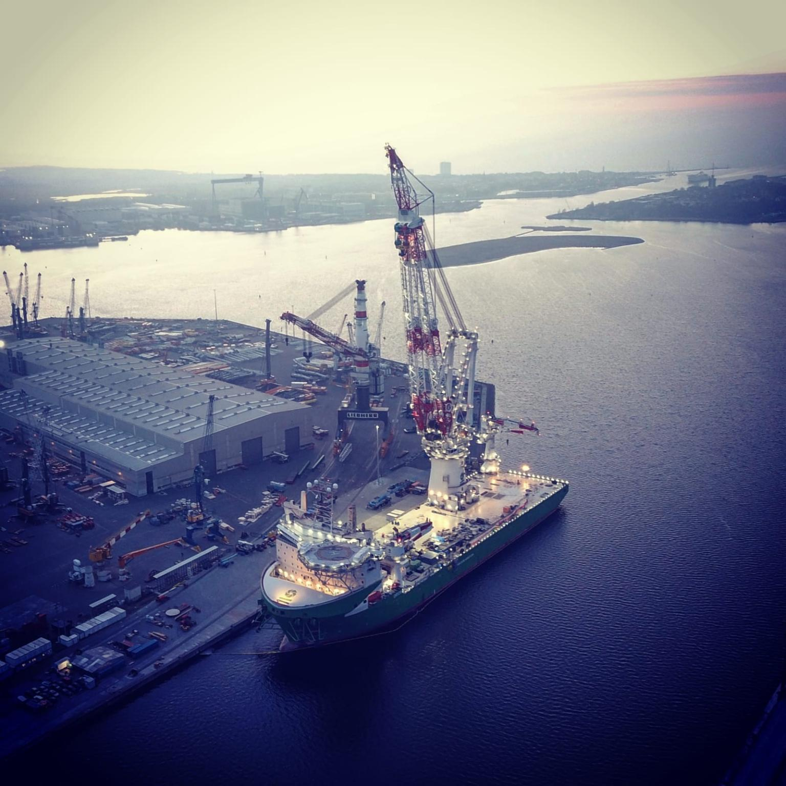 Photo of DEME's vessel Orion with the lifted crane
