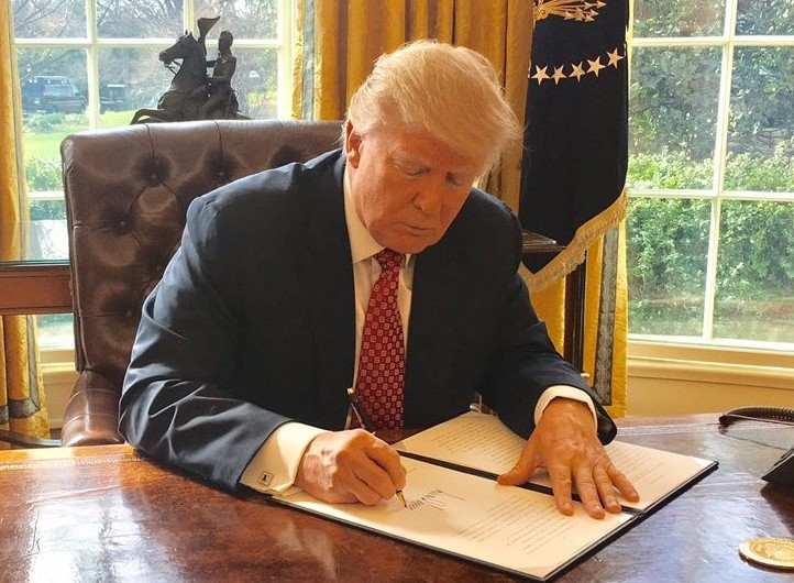 Donald Trump signing an executive order; Source: White House