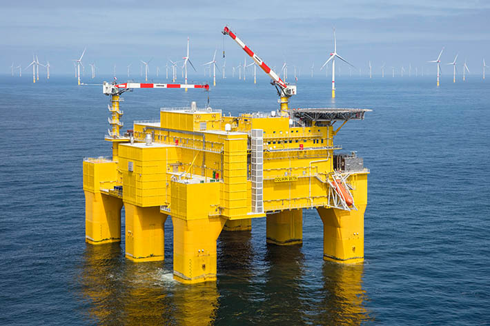 DolWin Beta yellow offshore platform with two Liebherr cranes on top