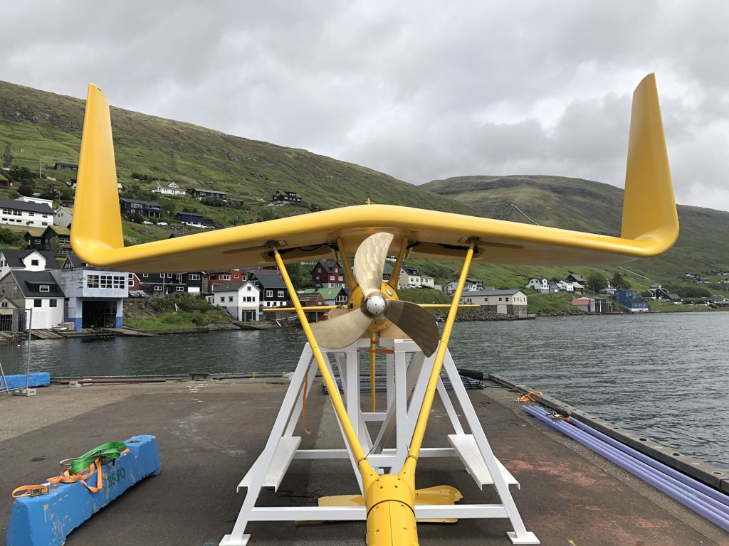 A photo of Minesto's DG100 system on the quayside in Vestmannsund, Faroe Islands (Courtesy of Minesto)