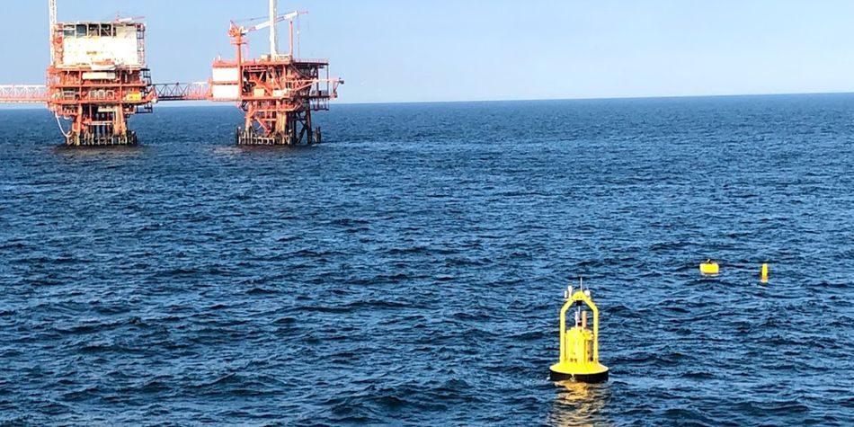 A photo illustration showing the PB3 PowerBuoy operating in the Adriatic Sea (Courtesy of Ocean Power Technologies)