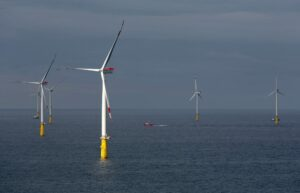 A photo of a Vattenfall offshore wind farm with a crew transfer vessel on site