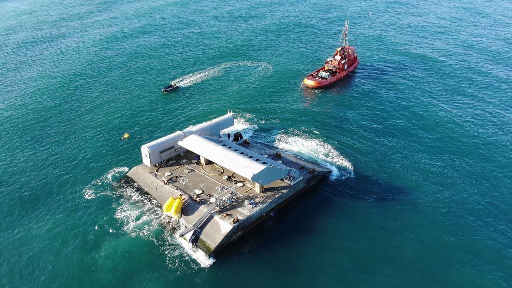 Photo of WaveRoller deployment (Courtesy of AW-Energy)