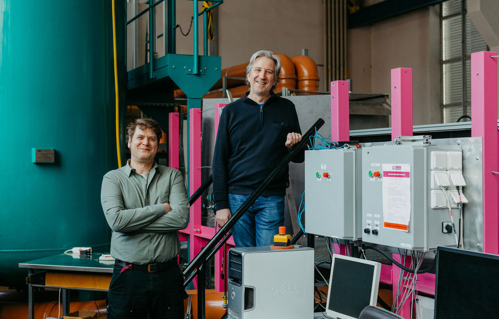 Photo of engineers Stefan Hoerner (L) and Roberto Leidhold (R) researching'intelligent' tidal turbines (Courtesy of