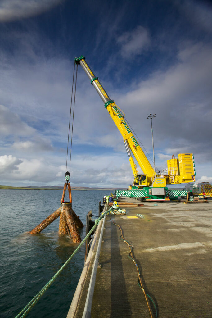 Photo showing the lifting of the tripod (Courtesy of Colin Keldie)