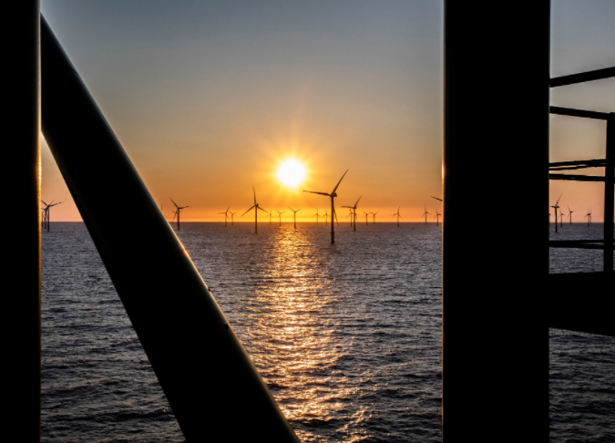 Sunset at an offshore wind farm