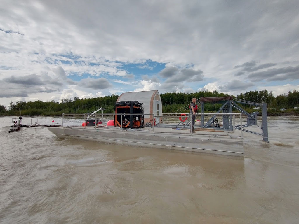 PMEC researcher Emily Browning stands on the barge at the Tanana River Test Site (Courtesy of University of Alaska Fairbanks/Photo by Ben Loeffler)