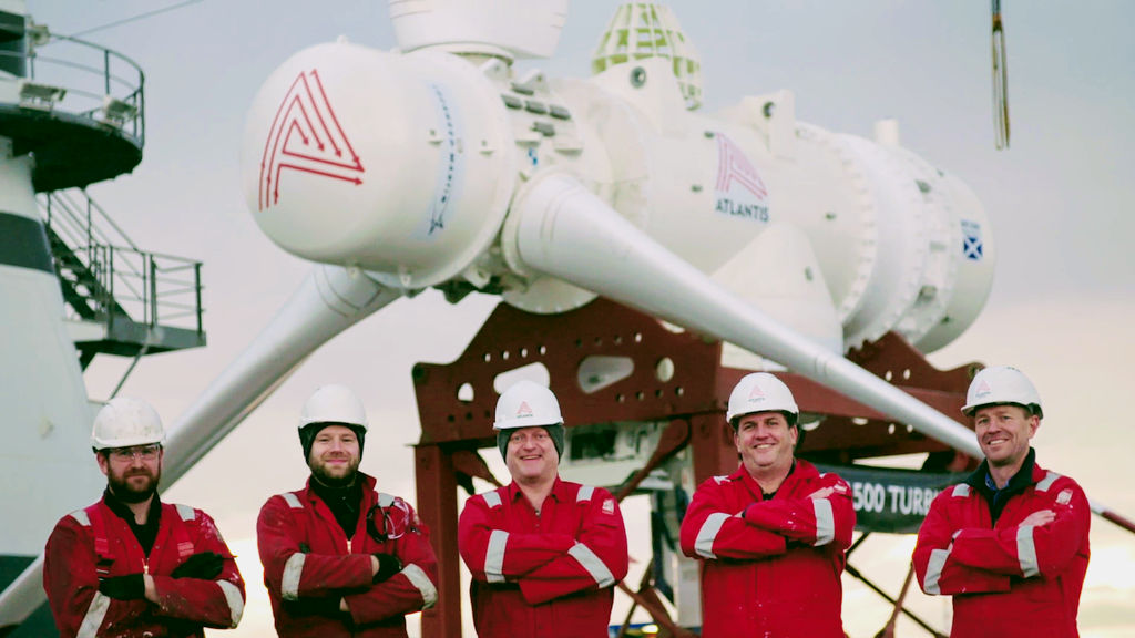 Photo showing SIMEC Atlantis' team in front of MeyGen's AR1500 tidal turbine (Courtesy of SIMEC Atlantis Energy)