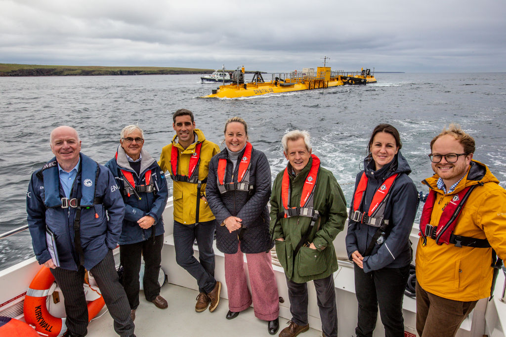 Group shot with UK energy minister at EMEC's Fall of Warness tidal test site (Courtesy of EMEC/Photo by Colin Keldie)