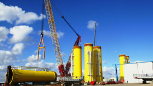 A photo of yellow transition pieces being upended at a yard