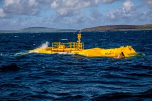Photo illustration showing Mocean Energy's Blue X in operation at EMEC (Photo by Colin Keldie)